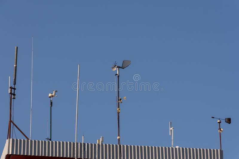 Different weather indicators on the roof and sky stock photo