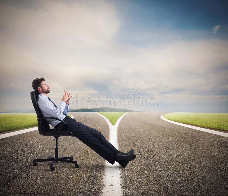 Difficult choices of a businessman at a crossroads. concept of confusion stock photo
