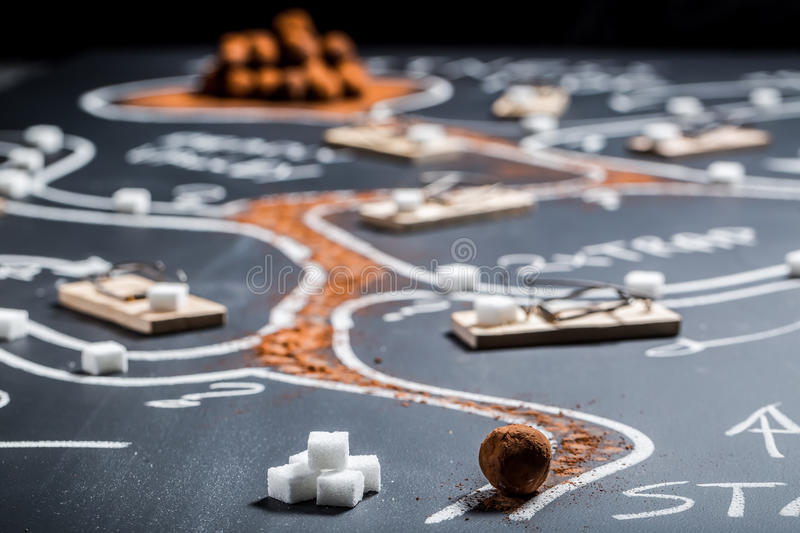 Difficult labyrinth to find the sweet treasure royalty free stock photo