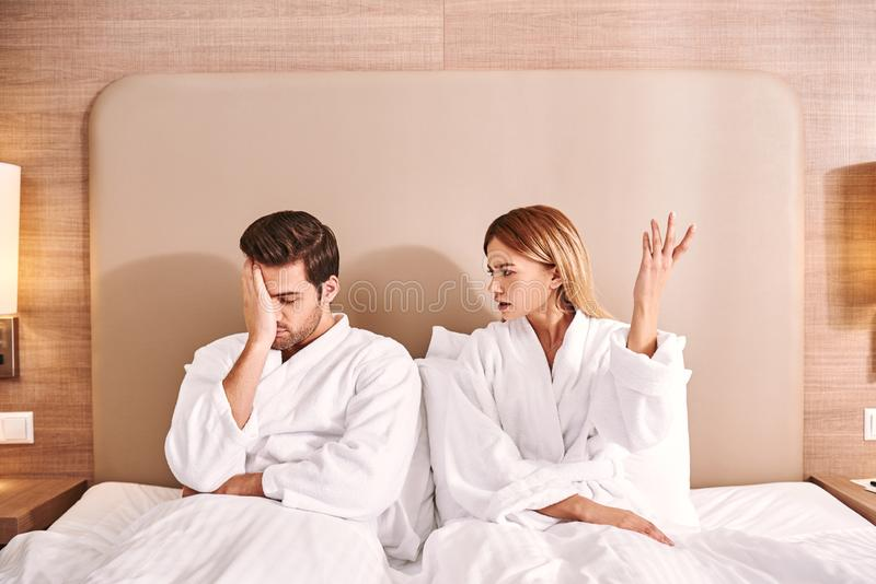 Difficult relationships. Woman have a quarrel with her boyfriend in hotel stock photos
