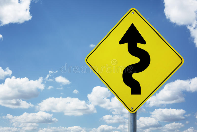 Difficult road ahead sign. Winding arrow road sign concept for business difficulties, problems and confusion stock image