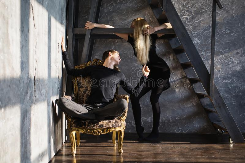 Difficult situation in life. Conceptual photography. A young men and young blonde women with long hair. Problems and difficulties in relations. Difficult royalty free stock image