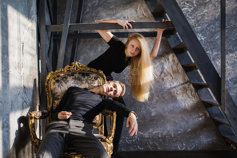 Difficult situation in life. Conceptual photography. A young men and young blonde women with long hair. Problems and difficulties in relations. Difficult stock photos