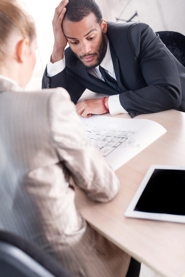 Difficult task for the project. Successful African businessman royalty free stock photos