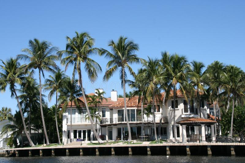 Difficult to chose. Beautiful houses  along the new River with their yacht in front of the house  in Fort Lauderdale royalty free stock photography