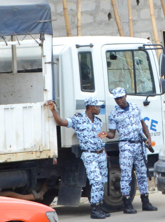 The difficulties of armed police intervention in Côte d`Ivoire royalty free stock photography