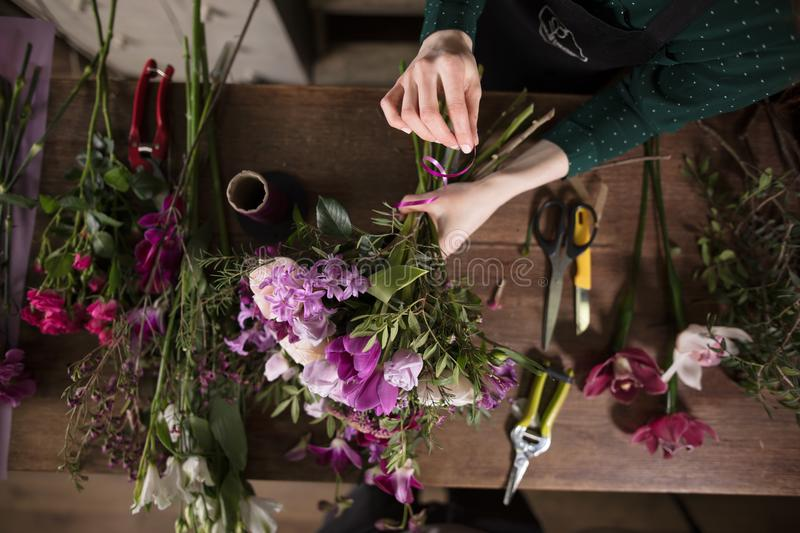 Difficulties in creating beautiful bouquets at flower shop. Tools for gardeners stock images