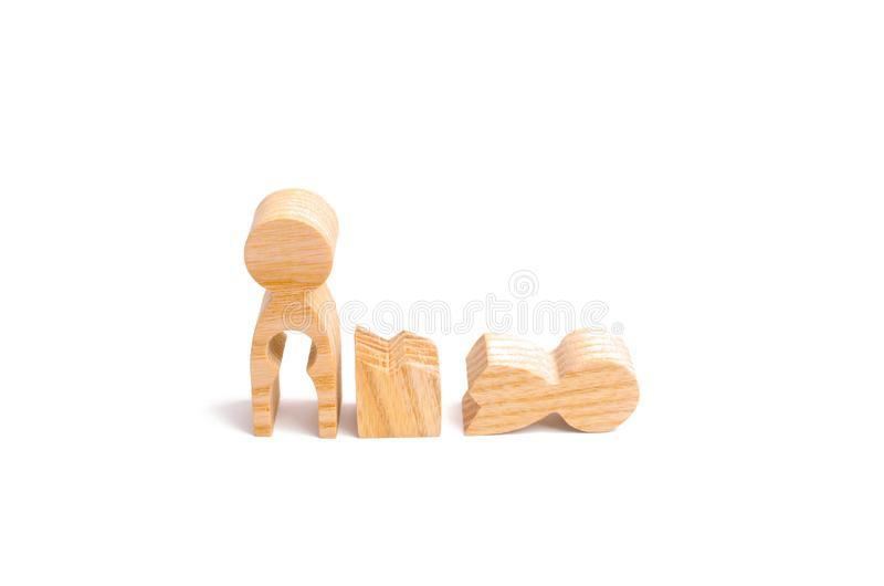 Difficulties in family life. Infertility. A broken wooden human figure and a mother with a void in the body. Strife in the family. One parent is broken royalty free stock images
