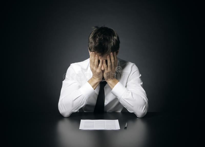 Difficulties at work. Portrait of desperate office manager covering his face with both hands royalty free stock photos