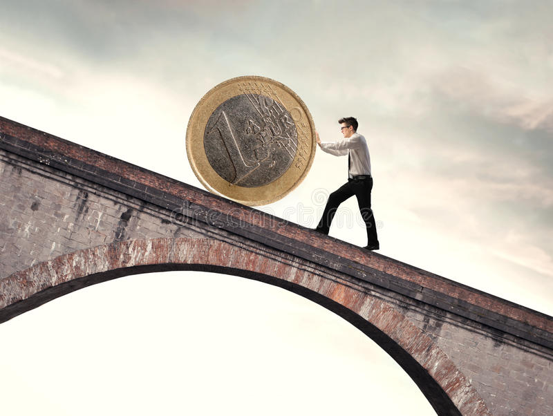 Difficulty. Businessman pushing an euro coin uphill royalty free stock image
