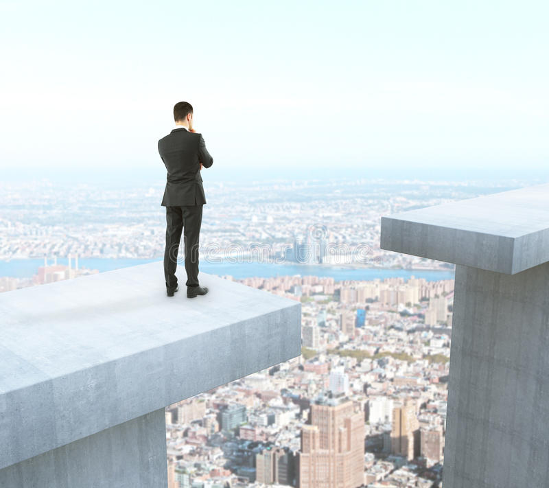 Difficulty concept. Businessman thinking how to overcome gap on city background. Difficulty concept. 3D Rendering royalty free illustration