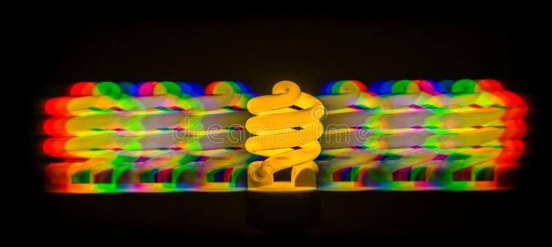 Diffractie van licht van de energy-saving lampen die, door grating wordt verkregen stock afbeeldingen