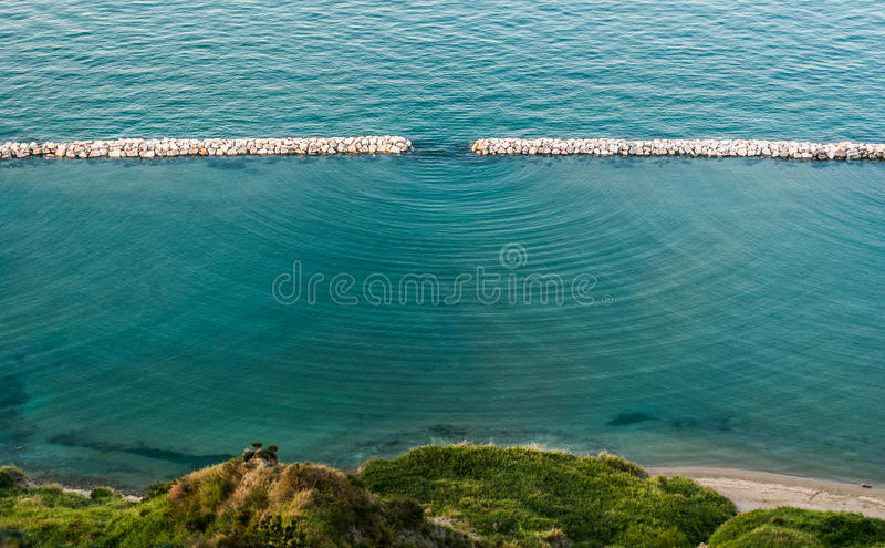 Diffraction waves in the sea seen along the coastline near Pesaro royalty free stock photos