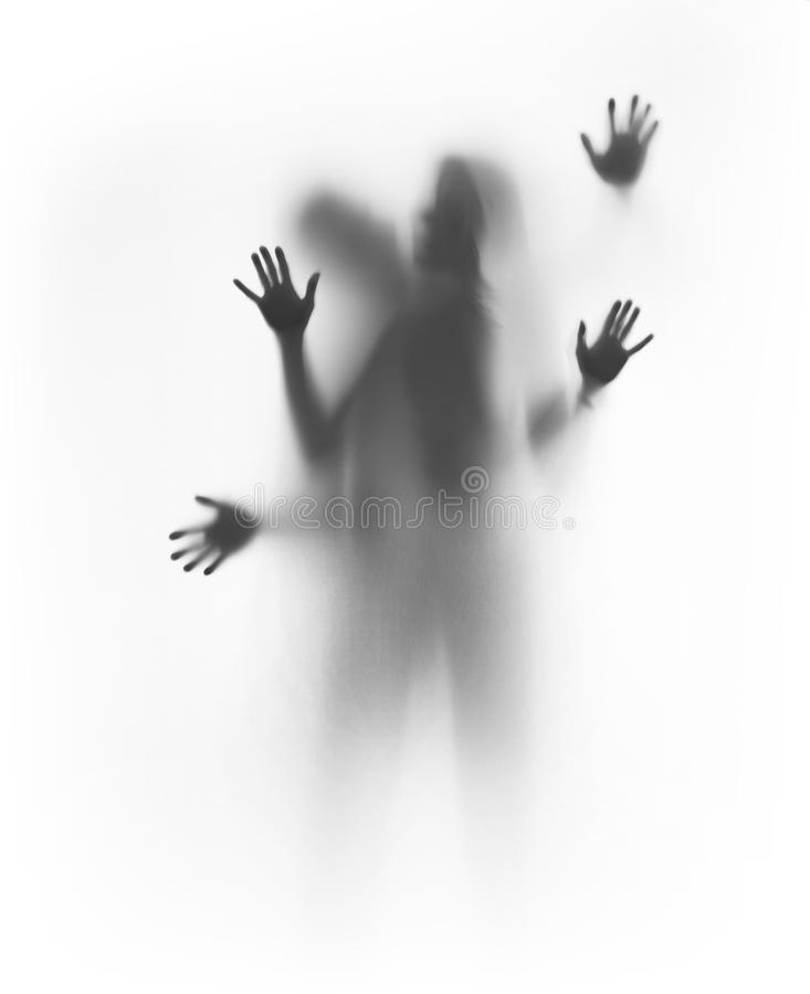 Diffuse silhouette of a couple behind a curtain. royalty free stock photo