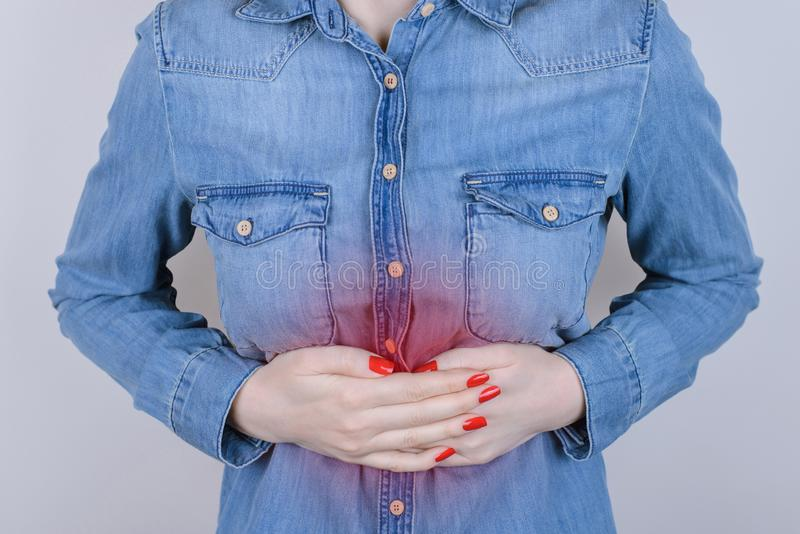 Digestion indigestion people person concept. Cropped close up photo of sad unhappy stressed depressed lady suffering from stomach- royalty free stock photography