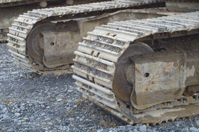 Digger βιομηχανία εργοτάξιων οικοδομής διαδρομής κινηματογραφήσεων σε πρώτο πλάνο καμπιών εκσκαφέων bulldoser στοκ εικόνες