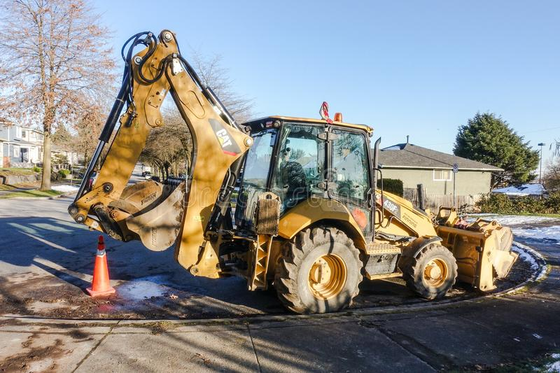 Digger parking on the street stock photography