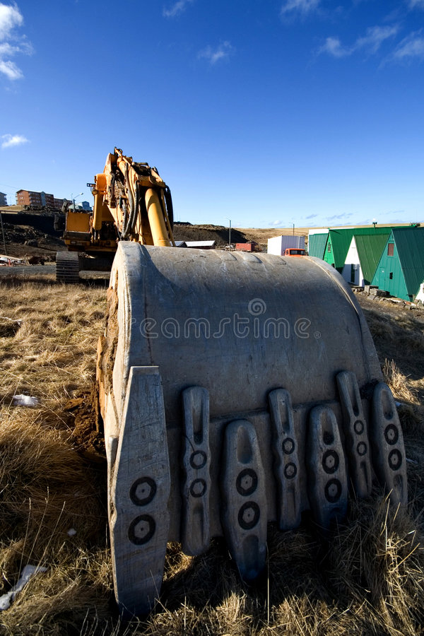 Digging. A heavy construction machinery digger royalty free stock images