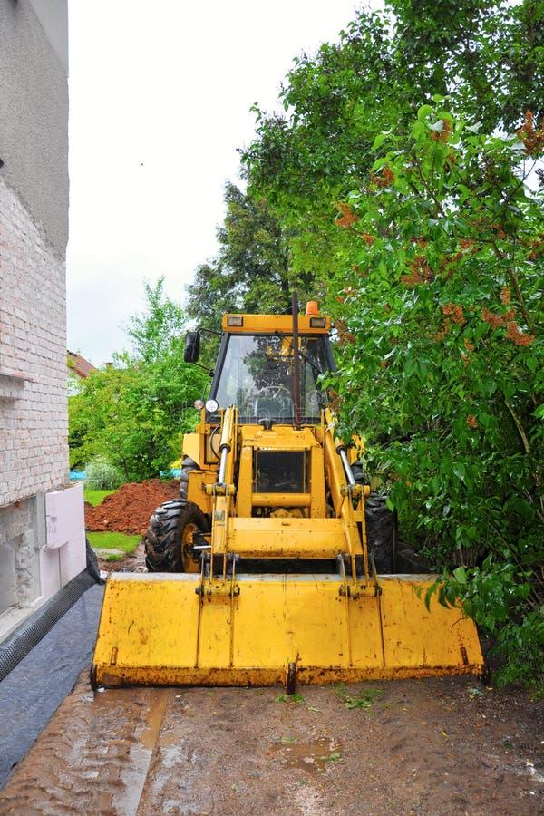 Digging excavator. In the garden stock image