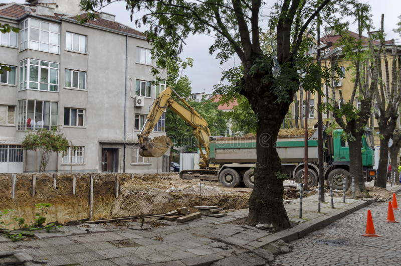 Digging foundation of new construction in the residential district. Sofia, Bulgaria stock photo