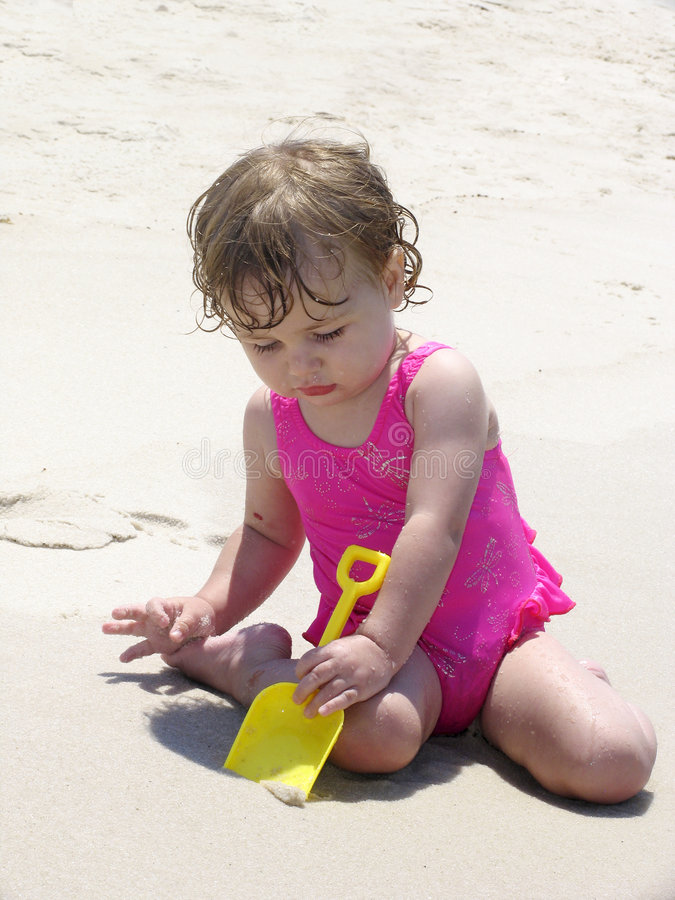 Download Digging in the sand stock photo. Image of beaches, looking - 159266