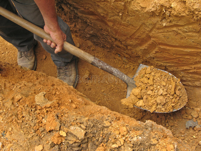 Digging a trench stock photos