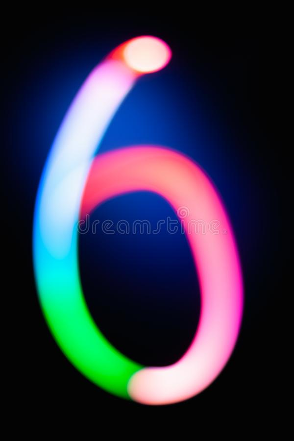 Digit 6. Six. Glowing numbers on dark background. Abstract light painting at night. Creative artistic colorful bokeh. New Year. Use it for build you own design stock illustration