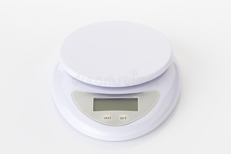 Digitaal elektronisch het gewichtssaldo van de voedselschaal stock foto
