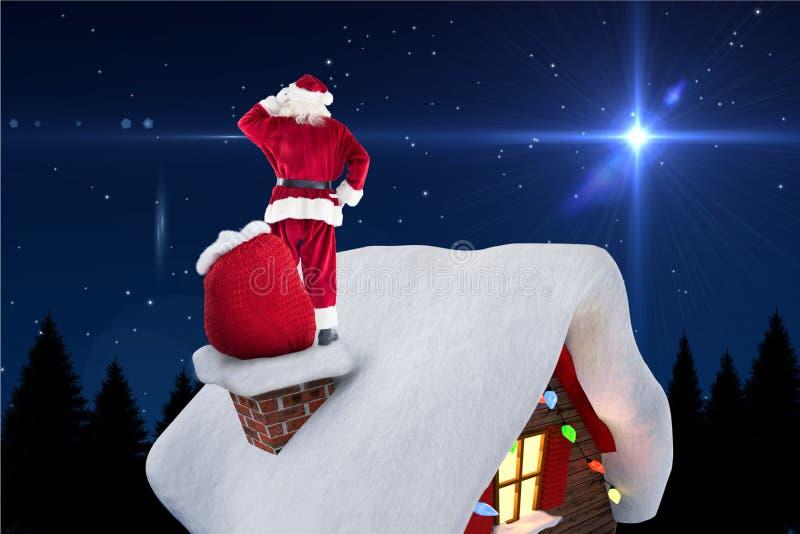 Digitaal geproduceerd beeld die van de Kerstman zich op huisdak bevinden stock foto's