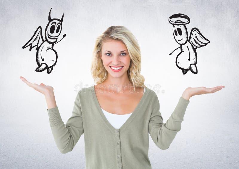 Digitaal samengesteld beeld van glimlachende vrouw met engel en duivel op haar hand stock fotografie