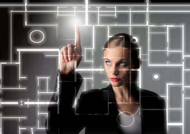 Digital. Beautiful business woman drawing a digital blueprint