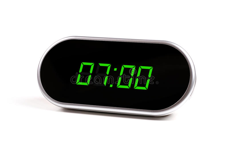 Digital alarm clock with green digits royalty free stock photo