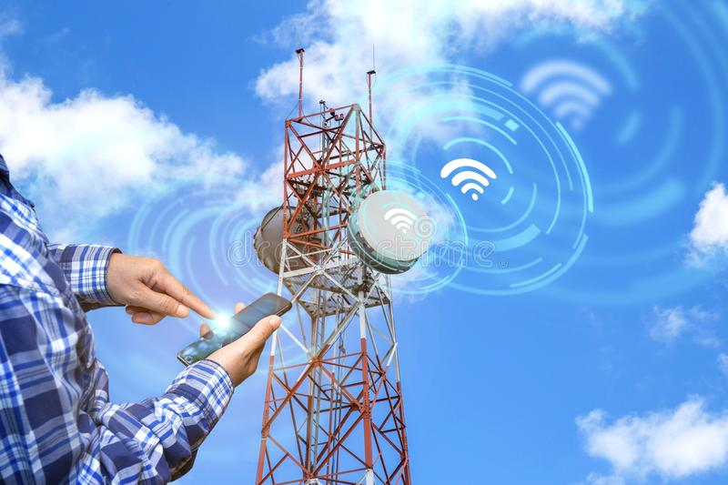 Digital alarm icon and man using smart phone devices in blue tone with network connection concept, smart city and wireless. Communication network, IOT internet stock photo