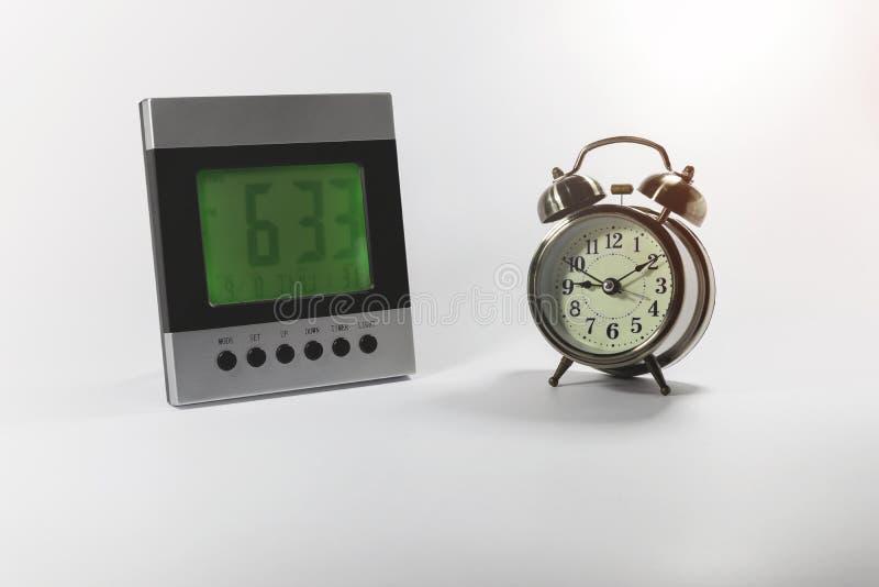 Digital and analog alarm clock. On white background royalty free stock images