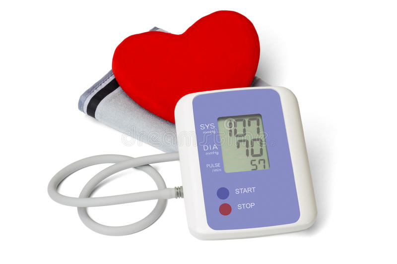 Digital blood pressure meter with heart symbol. Digital blood pressure meter with love heart symbol on white background stock images