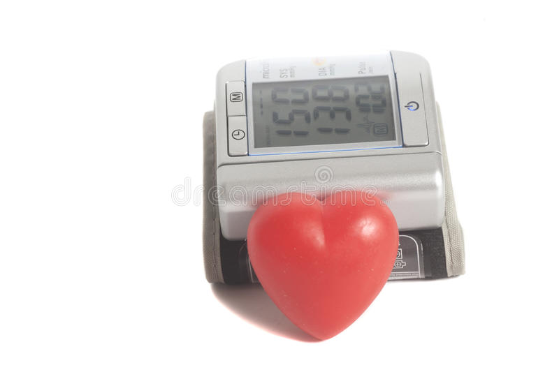Digital blood pressure meter with heart symbol. On white background stock photo