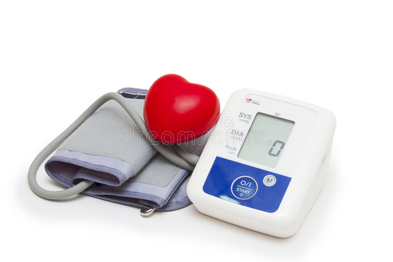 Digital blood pressure meter with love heart symbol on white background. Digital blood pressure meter with love heart symbol on white royalty free stock photography