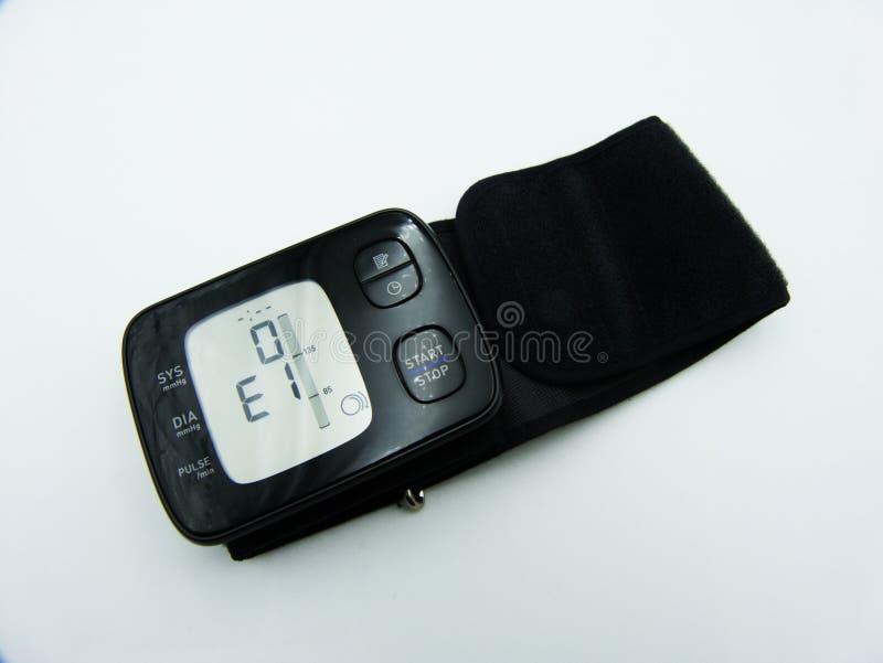 Digital Blood Pressure wrist monitor display, white background stock photo