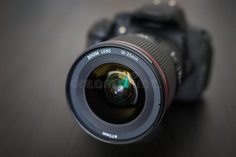 Digital camera or DSLR with camera lens with lense reflections. royalty free stock photos