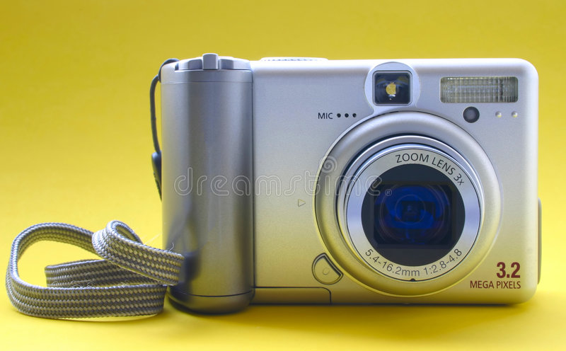 Digital camera - front view. No trademarks stock photography