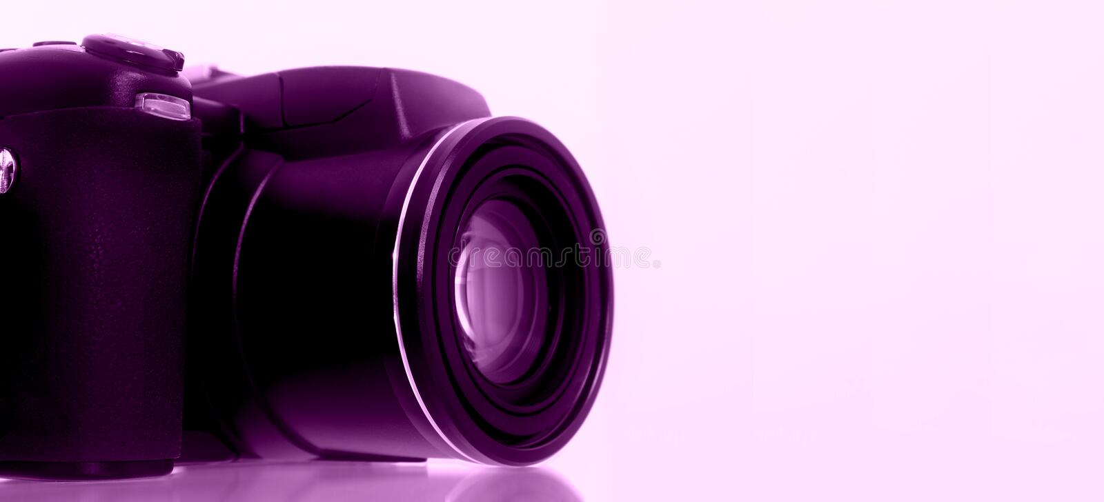 Digital Camera with Grape Background stock images