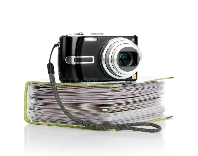 The digital camera and the photograph album royalty free stock photos