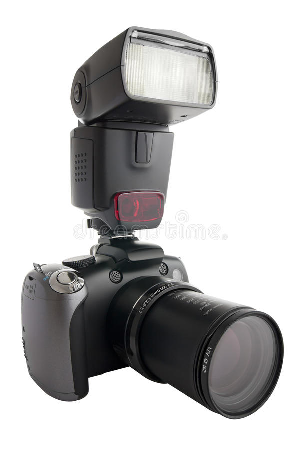 Digital camera with zoom barrel and flash. A digital camera (bridge, high end compact) with zoom barrel extended, and one external flash attached to the hot shoe royalty free stock photos