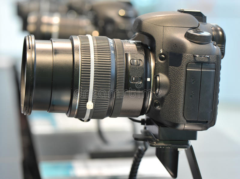 Digital cameras show at shop. Black digital single lens reflection cameras show at shop royalty free stock images