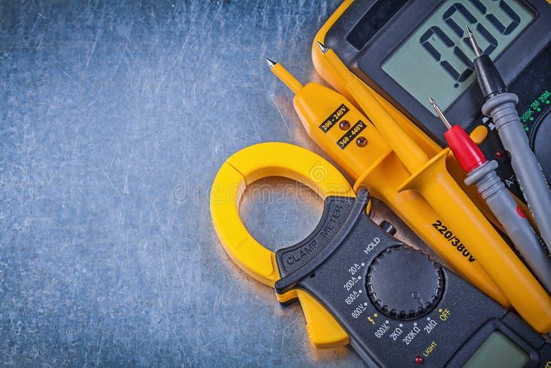 Digital clamp meter electrical tester multimeter on metallic bac royalty free stock photos
