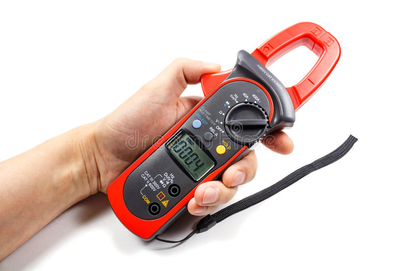 Digital clamp multimeter in man`s hand on a white background royalty free stock photos