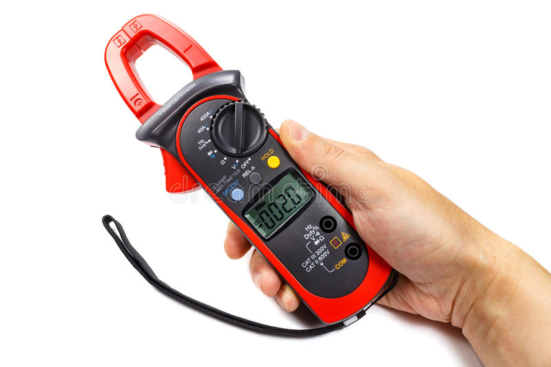 Digital clamp multimeter in man`s hand on a white background royalty free stock photography