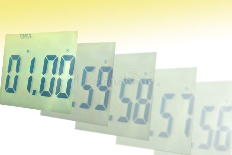 Digital clock blur to one minute. A digital clock blur to one minute stock photo