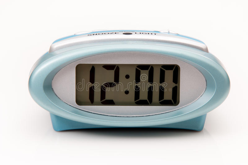 Digital clock displaying 12:00 o`clock on a white background royalty free stock images
