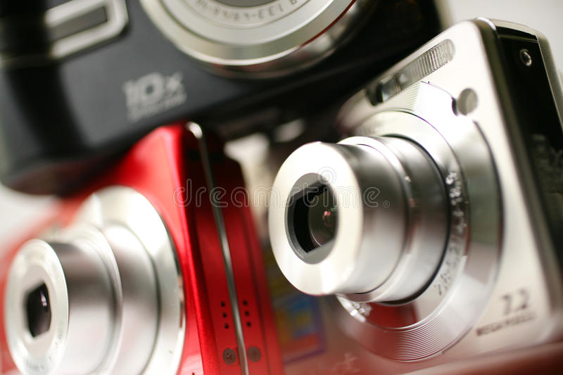 Digital compact. A pile of digital cameras of different colors, perfect for an illustration for a text about photography royalty free stock photography